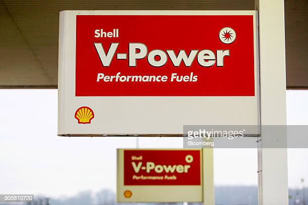 A sign for Vpower fuel stands above petrol pumps at a Royal Dutch Shell Plc gas station in Brentwood UK on Wednesday Jan 20 2016 Shell which is...