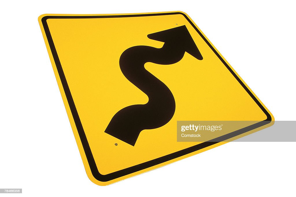 Sign for winding road ahead : Stock Photo