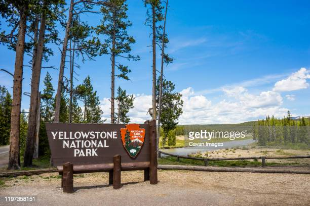 sign for yellowstone national park at the south entrance, wyoming - national park stock pictures, royalty-free photos & images