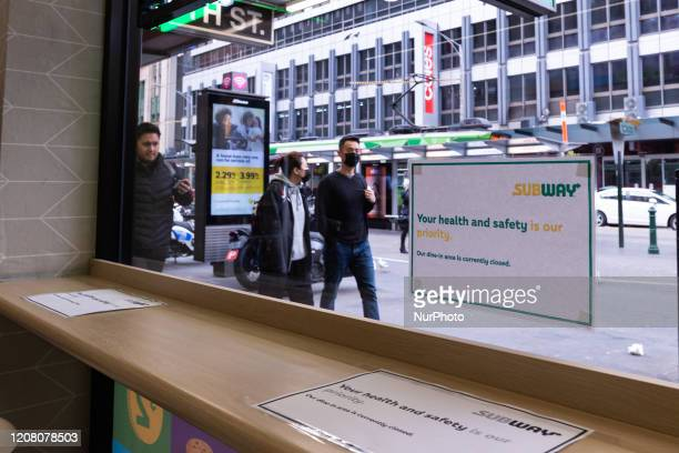 A sign from a Subway fast food restaurant is seen as the coronavirus continues to rapidly spread in Melbourne Australia on March 23 2020 From midday...