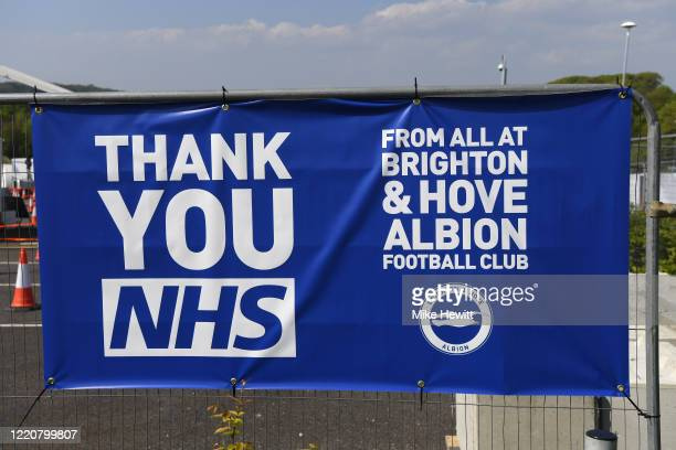 Sign from Brighton and Hove Albion football club thanking the NHS is displayed at the Amex Stadium, which is being used as a coronavirus testing...