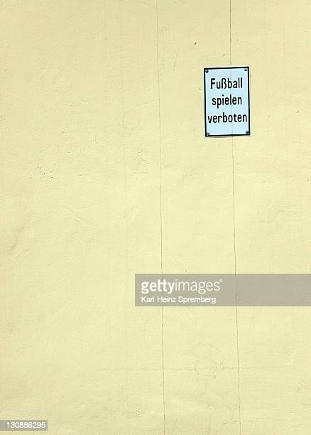 sign fussball spielen verboten, germany for no football games, on a wall, germany - captions stock photos and pictures