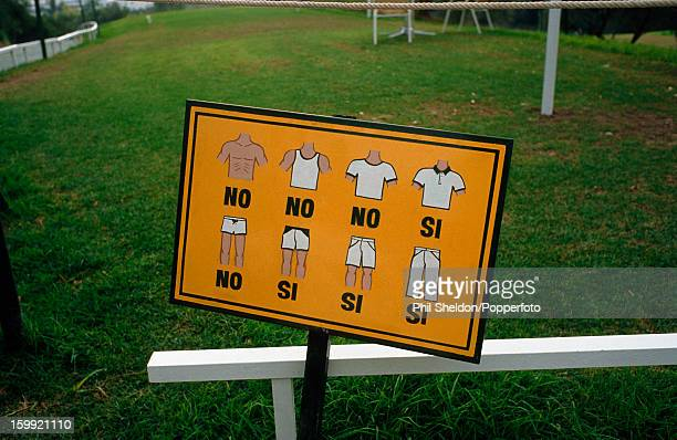 A sign graphically indicating the dress code at Las Brisas Golf Club in Marbella Spain circa 1989
