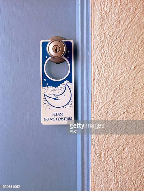 Sign hanging at door in hotel