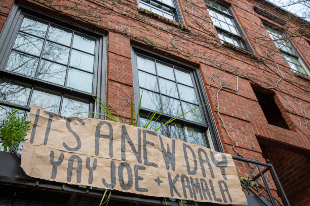 A sign hanging in front of a town house in Portland Oregon celebrating the inauguration of President Joe Biden.