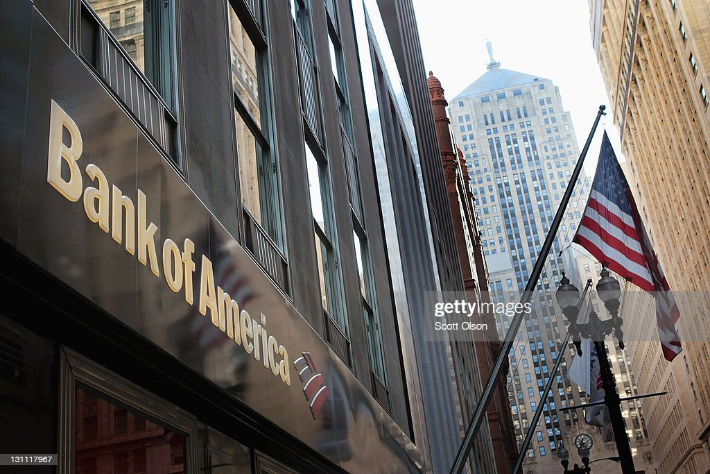 A sign hangs above a Bank of America branch in the Financial District on November 1, 2011 in Chicago, Illinois. Bank of America Corp. has reportedly announced they will drop its plan to charge customers a $5-per-month fee for making purchases with their debit cards.