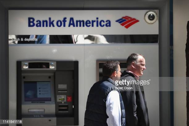 A sign hangs above an ATM machine outside of a Bank of America branch in the Loop on April 09 2019 in Chicago Illinois The banking giant has...