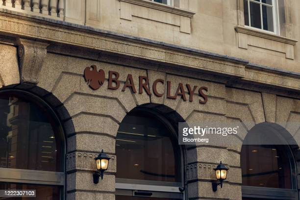 A sign hangs above an entrance to a branch of Barclays Plc bank in the City of London UK on Tuesday June 23 2020 Many of the financial districts most...