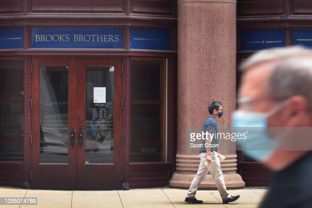 Sign hangs above the entrance of a shuttered Brooks Brothers store in the financial district on July 08, 2020 in Chicago, Illinois. The retailer...