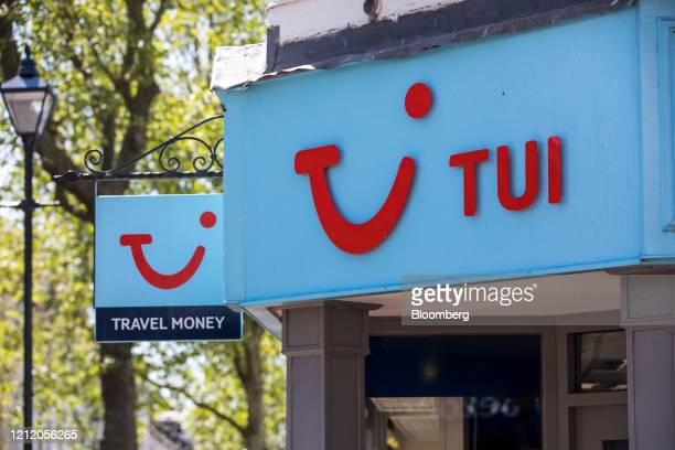 Sign hangs above the entrance to a closed travel agency store, operated by Tui AG, in Ashford, U.K., on Wednesday, May 6, 2020. Lockdown restrictions...