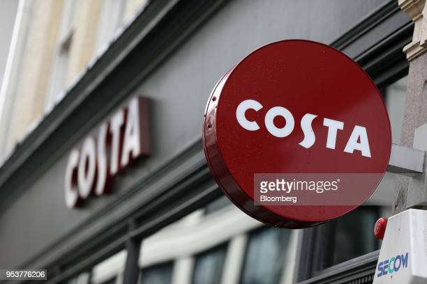 A sign hangs above the entrance to a Costa Coffee shop operated by Whitbread Plc in London UK on Wednesday May 2 2018 Whitbread is betting that its...