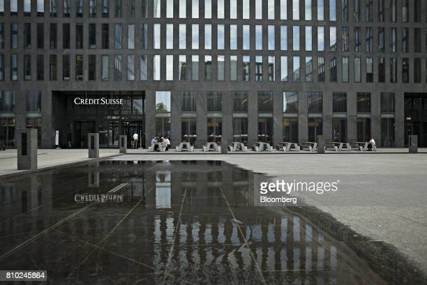 A sign hangs above the entrance to a Credit Suisse Group AG office building in Zurich Switzerland on Thursday July 6 2017 Switzerland is tightening...
