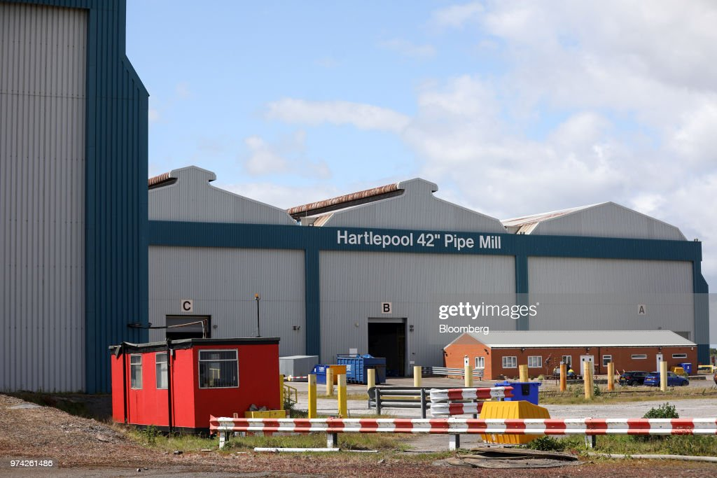 A sign hangs above the entrance to the 42 inch pipe mill at the SAW Pipe Mills, operated by Liberty Commodities Ltd., in Hartlepool, U.K., on Thursday, June 14, 2018. Steel and aluminumtariffsimposed by the U.S. in March may already be filtering through to prices charged by American producers of the metals. Photographer: Chris Ratcliffe/Bloomberg via Getty Images