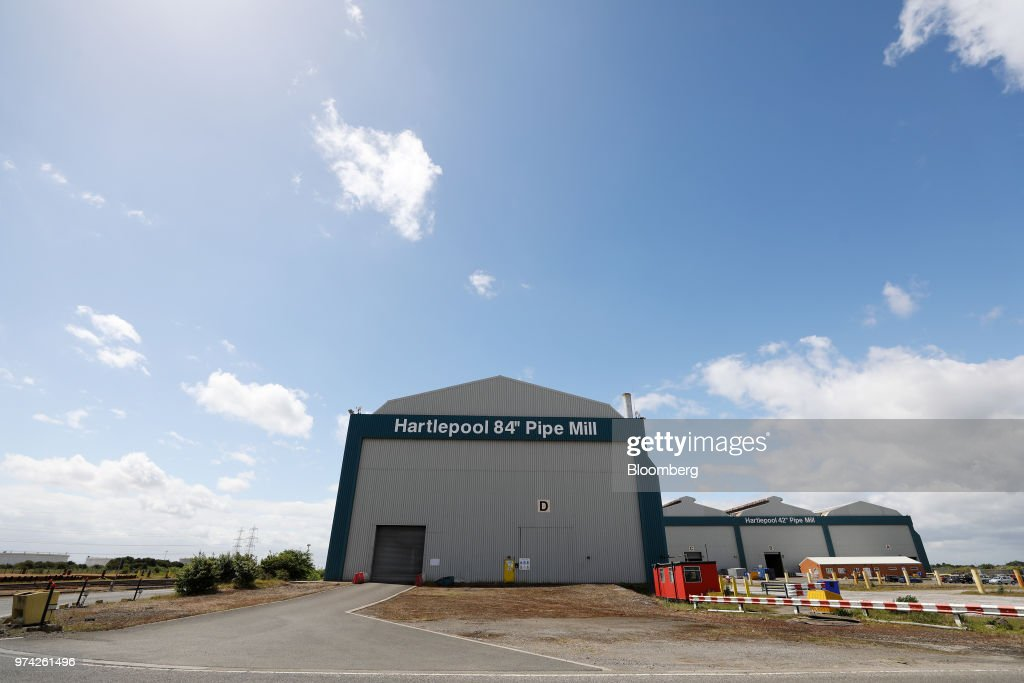 A sign hangs above the entrance to the 84 inch pipe mill at the SAW Pipe Mills, operated by Liberty Commodities Ltd., in Hartlepool, U.K., on Thursday, June 14, 2018. Steel and aluminumtariffsimposed by the U.S. in March may already be filtering through to prices charged by American producers of the metals. Photographer: Chris Ratcliffe/Bloomberg via Getty Images