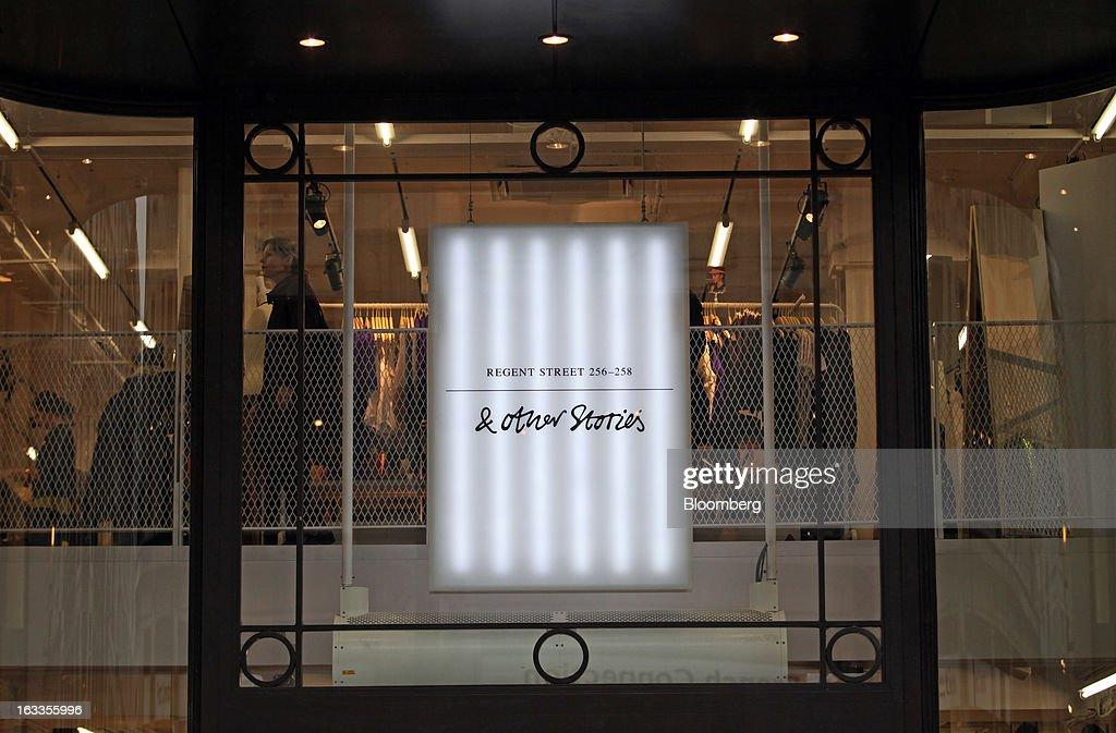 A sign hangs above the entrance to the new '& Other Stories' store operated by Hennes & Mauritz AB (H&M) on the launch day in London, U.K., on Friday, March 8, 2013. The Swedish retailer is diversifying with a sixth brand after falling behind larger competitor Inditex SA in the race for the price-sensitive fashionista's euro. Photographer: Chris Ratcliffe/Bloomberg via Getty Images