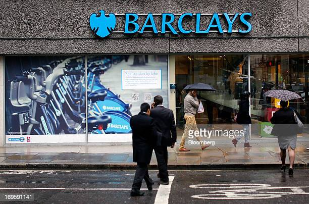 A sign hangs above the windows of a Barclays Plc bank branch in London UK on Tuesday May 28 2013 Britain's four biggest banks will have eliminated...