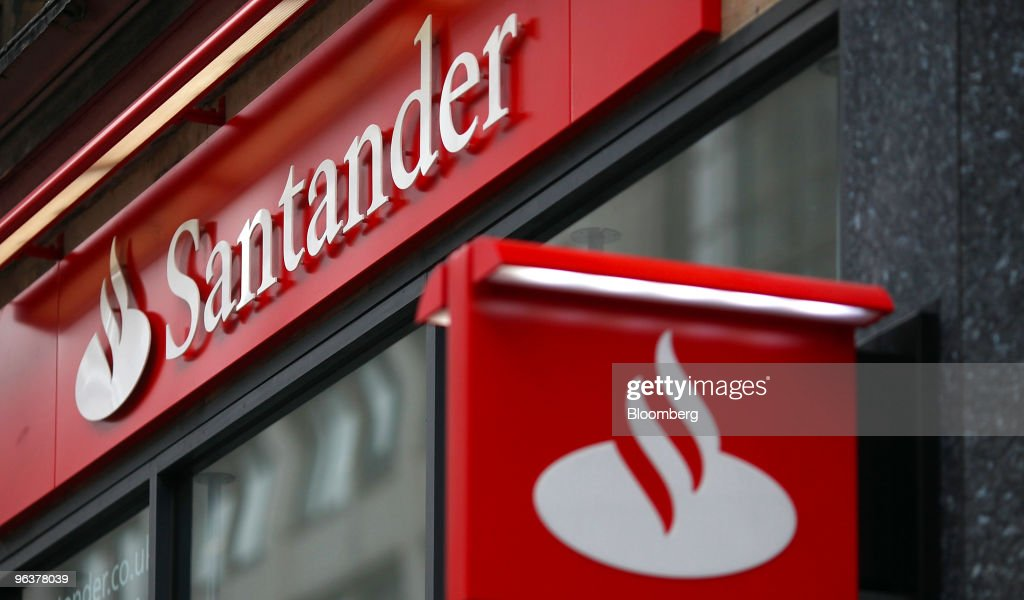 A sign hangs from a branch of Banco Santander in London, U.K., on Wednesday, Feb. 3, 2010. Banco Santander announce FY earnings tomorrow. Photographer: Simon Dawson/Bloomberg via Getty Images