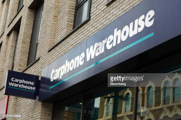 A sign hangs from a Carphone Warehouse store operated by Dixons Carphone Plc in London UK on Tuesday March 17 2020 Dixons plans to close 531...