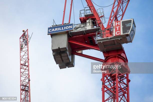 A sign hangs from a crane working on the Arundel Great Court development operated by Carillion Plc in London UK on Monday Jan 15 2018 Carillion a UK...