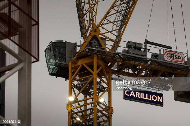 A sign hangs from a crane working on the Barts Square development operated by Carillion Plc in London UK on Monday Jan 15 2018 Carillion a UK...