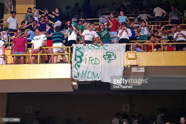 A sign hangs from the rafters for Larry Bird of the Boston Celtics during a game played in 1987 at the Boston Garden in Boston Massachusetts NOTE TO...