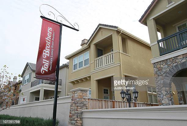 A sign hangs in front of a newly constructed Toll Brothers housing development on December 2 2010 in Dublin California Toll Brothers reported fourth...