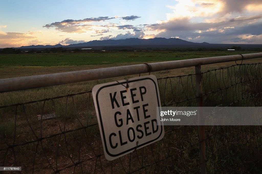 A sign hangs in front of farmland on September 29, 2016 near Saint David, Arizona. Recent rain has greened the typically arid landscape.
