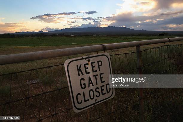 A sign hangs in front of farmland on September 29 2016 near Saint David Arizona Recent rain has greened the typically arid landscape