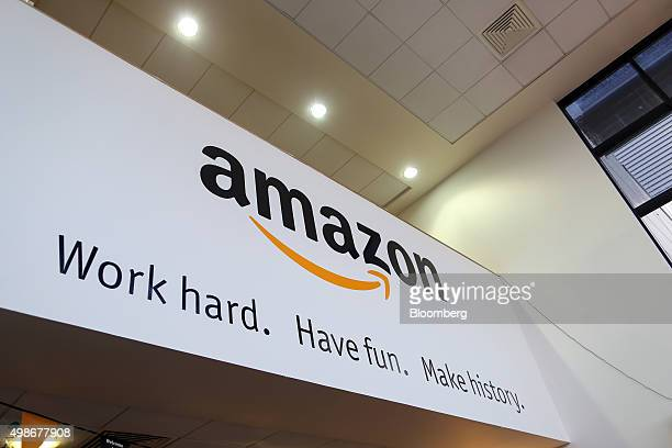 A sign hangs in the reception at the Amazoncom Inc fulfillment center in Hemel Hempstead UK on Wednesday Nov 25 2015 WalMart and Amazon's toy pricing...