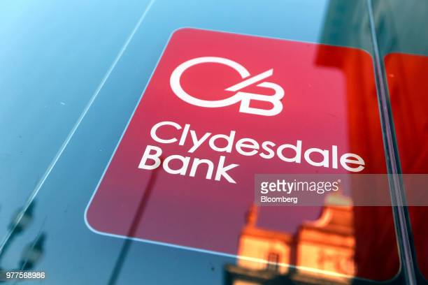 A sign hangs in the window of a branch of Clydesdale Bank Plc owned and operated by National Australia Bank Ltd in London UK on Tuesday Jan 19 2016...