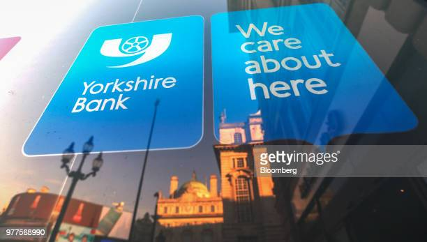 A sign hangs in the window of a branch of Yorkshire Bank Plc owned and operated by National Australia Bank Ltd in London UK on Tuesday Jan 19 2016...