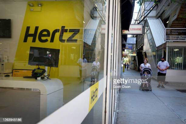 Sign hangs in the window of a Hertz rental car office on August 04, 2020 in Chicago, Illinois. Hertz is selling more than 180,000 vehicles as they...