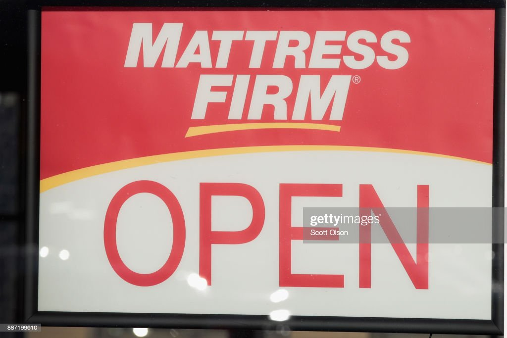 A sign hangs in the window of a Mattress Firm store on December 6, 2017 in Chicago, Illinois. Steinhoff International Holdings N.V., which is the parent company of Mattress Firm, saw its stock value plummet more than 60 percent today after the resignation of CEO Markus Jooste and an announcement from the company that it was launching an investigation into accounting irregularities.
