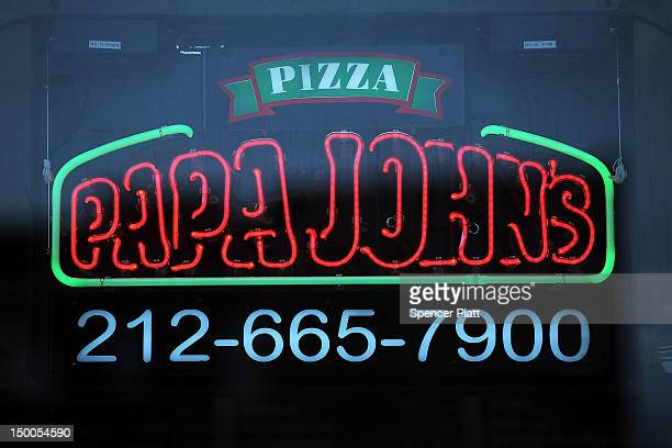 A sign hangs in the window of a Papa Johns pizza restaurant on August 9 2012 in New York City Papa JohnÕs chief executive John Schnatter has stated...