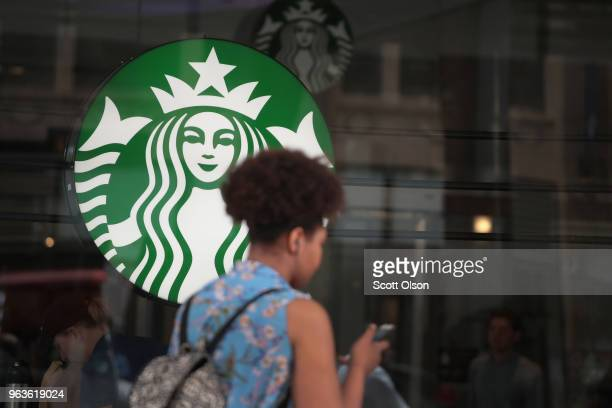 A sign hangs in the window of a Starbucks store on May 29 2018 in Chicago Illinois In reaction to a highlypublicized incident in which two black...