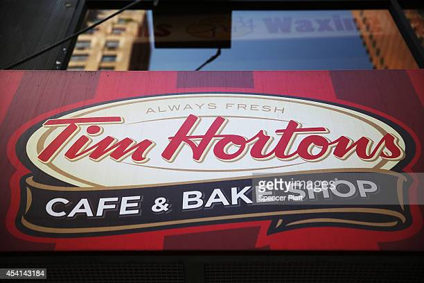 A sign hangs on a Tim Horton's cafe in Manhattan on August 25 2014 in New York City It has been confirmed that American fast food giant Burger King...
