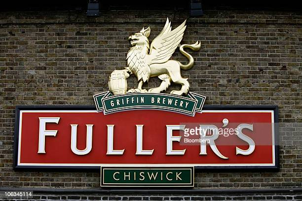 A sign hangs on a wall outside the Fuller Smith Turner Plc brewery in London UK on Friday Oct 29 2010 Fuller's brews beer and ale for sale in its own...