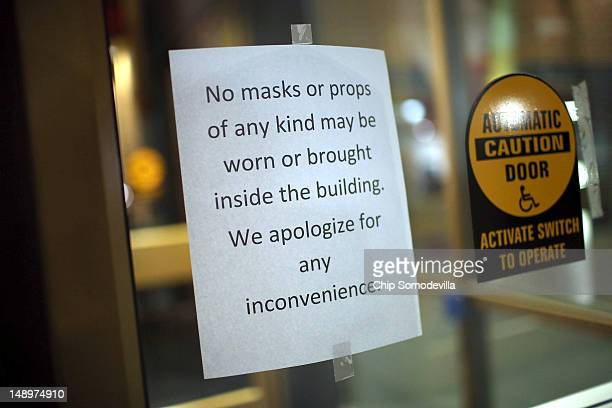 A sign hangs on the door leading into the AMC Arapahoe Crossing 16 movie theater July 20 2012 in Aurora Colorado The AMC Arapahoe Crossing 16 lies 15...