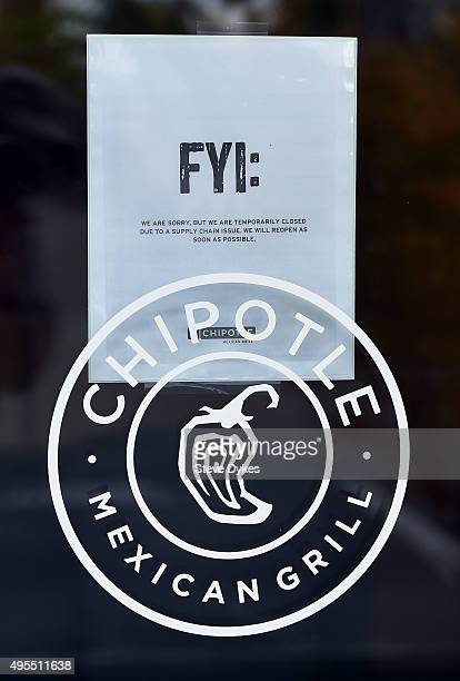 A sign hangs on the door of a Chipotle Mexican Grill store location in on November 3 2015 in Vancouver Washington Chipotle Mexican Grill is...