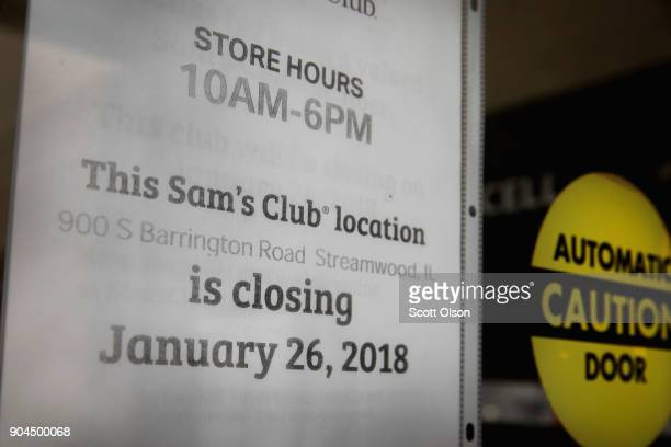 A sign hangs on the door of a Sam's Club store on January 12 2018 in Streamwood Illinois The store is one of more 60 sheduled to close nationwide by...