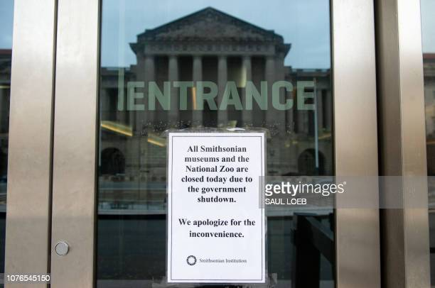 A sign hangs on the door of the Smithsonian National Museum of American History stating that the museum is closed because of a partial government...
