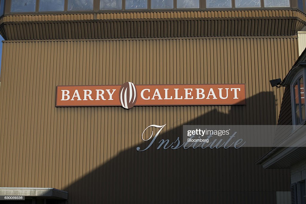 A sign hangs on the exterior of the Barry Callebaut AG Institute in Wieze, Belgium, on Wednesday, Dec. 16, 2016. The 3-D printing process can cut down the time and effort in crafting desired products, while expanding design possibilities that may be too intricate for human hands. Photographer: Jasper Juinen/Bloomberg via Getty Images