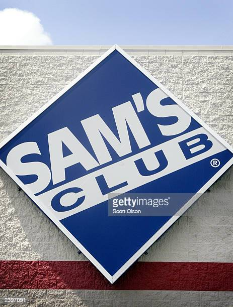 A sign hangs on the front of a Sam's Club store August 13 2003 in Des Plaines Illinois WalMart Stores Inc the parent company of Sam's Club reported...