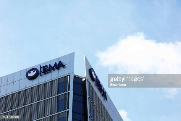 A sign hangs on the top of 30 Churchill Place which houses the European Medicines Agency stands in the Canary Wharf financial business and shopping...