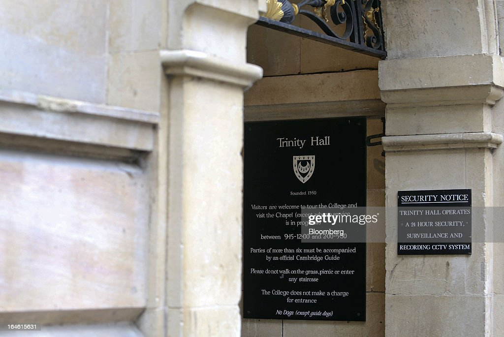 A sign hangs on the wall at the entrance to Trinity Hall, part of the University of Cambridge, in Cambridge, U.K., on Friday, March 22, 2013. In 2011, the U.K.'s government unveiled a plan to reduce state spending on higher education and shift more of the costs to students through tuition increases and a loan program. Photographer: Chris Ratcliffe/Bloomberg via Getty Images