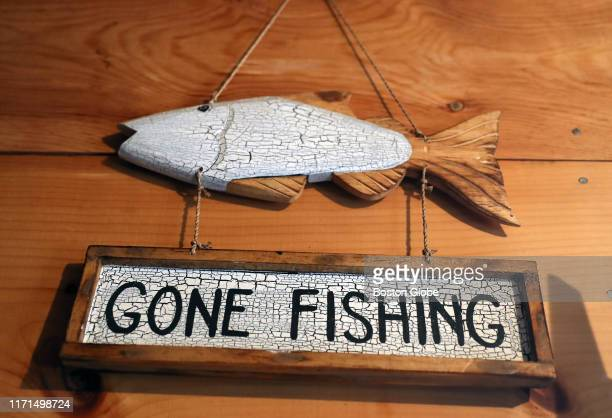A sign hangs on the wall in the garageof Dr Molly Lutcavage who is conducting scientific research on gonads from tuna out of her garage lab at her...