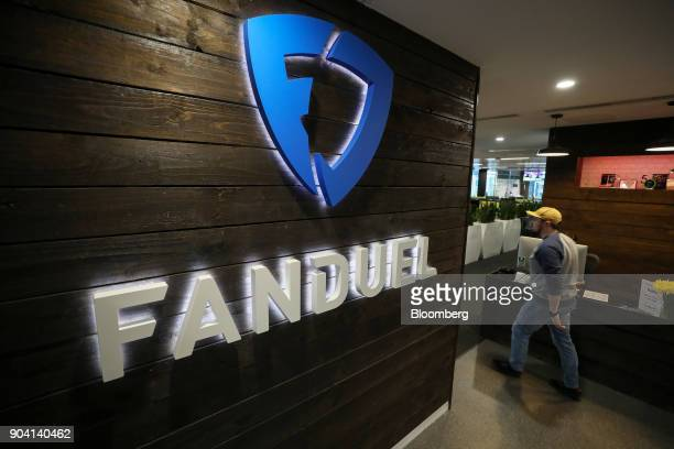 A sign hangs on the wall in the reception area at Fanduel Inc's offices in Edinburgh UK on Tuesday Feb 7 2017 More coders are choosing to live in...