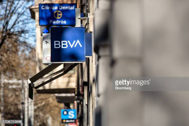 A sign hangs outside a Banco Bilbao Vizcaya Argentaria SA bank branch in Barcelona Spain on Saturday March 7 2020 Spanish bank shares soared after...