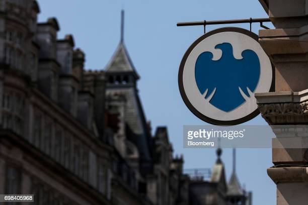 A sign hangs outside a Barclays Plc bank branch in London UK on Tuesday June 20 2017 Barclays Plc and four former executives were charged with...
