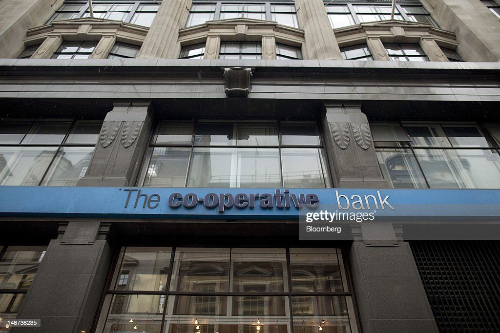 A sign hangs outside a Co-Operative Bank Plc branch in London, U.K., on Thursday, July 19, 2012. Lloyds Banking Group Plc agreed to sell 632 branches to Co-Operative Bank Plc for an initial 350 million pounds ($548 million), as the U.K.'s biggest mortgage lender divests assets to comply with its government bailout. Photographer: Simon Dawson/Bloomberg via Getty Images
